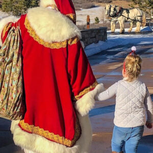 Santa Clause walking with young girl